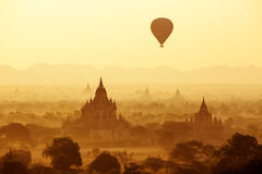 Air balloons over Buddhist temples at sunrise Stock Image