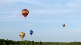 Air balloons over the forest stock footage