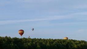 Air balloons over the forest stock video footage