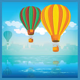 Air balloons over water Stock Photography