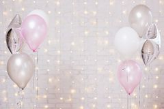 Air balloons over white brick wall background with lights. Colorful air balloons over white brick wall background with lights royalty free stock photos