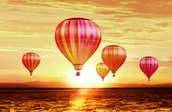 Air balloons on sunset. Soar hot air balloons on sunset royalty free stock photography