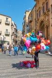 Air balloons vendor in Cefalu royalty free stock photo