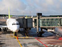 Air Baltic airplane in Riga airport. Air Baltic is the Latvian flag carrier airline and a low-cost carrier Stock Photo