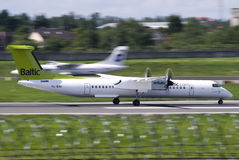Air Baltic dashQ. Taking off at Vilnius intl airport Stock Images