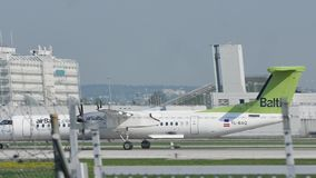 Air Baltic De Havilland Canada DHC-8-400 YL-BAQ. AirBaltic plane taking off from Munich Airport, MUC spring stock video