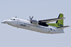 Air Baltic Fokker 50. Taking off at Vilnius intl airport Royalty Free Stock Images