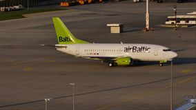 Airbalric jet plane taxiing in Munich Airport, MUC. Air Baltic plane on runway in Munich Airport, MUC, spring stock video