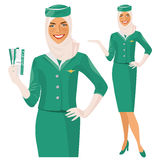 Air beautiful arabian hostess. Muslim Stewardess holding ticket in her hand. Woman in official clothes Royalty Free Stock Images