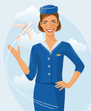 Air beautiful hostess. Stewardess holding ticket in her hand. Woman in official clothes. Stewardess holding ticket in her hand Stock Photography