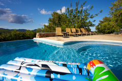 Air bed floating on a swimming pool Stock Photos