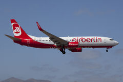 Air Berlin Boeing B737-800. Lanzarote Island, Spain - October 8, 2011: An Air Berlin Boeing 737-800 on approach to Lanzarote Airport (Canary Islands). Air Berlin royalty free stock photo