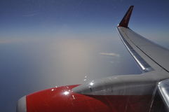Air Berlin Wing with Flight Turbine above Clouds Stock Image
