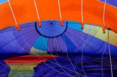 Air blowing into the balloon. Royalty Free Stock Image