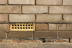 Air Brick and Damp Proofing. Air brick and damp proof course on a house wall Royalty Free Stock Photos