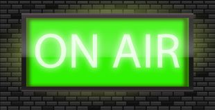 On Air broadcast radio sign on black bricks wall background Royalty Free Stock Image