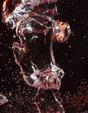Air bubble in rose colored water Stock Images