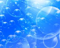 Air bubbles on a light blue background Stock Images