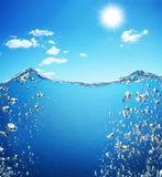 Air bubbles rise from the bottom of the ocean. To the surface Royalty Free Stock Photos