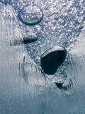 Air bubbles trapped under frozen ice surface Royalty Free Stock Photos