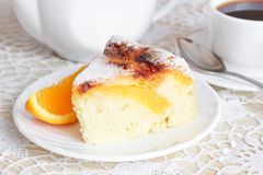 Air cake with oranges. And sugar  on white Royalty Free Stock Image