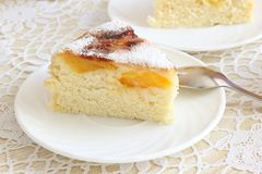 Air cake with oranges. And sugar  on white Stock Photography