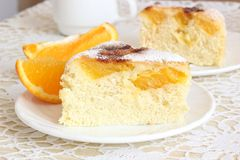 Air cake with oranges. And sugar  on white Royalty Free Stock Images