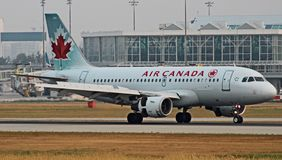 Air Canada Airbus Lands. An Air Canada Airbus A319 lands on the runway at YVR in Canada royalty free stock photography