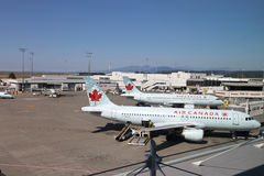 Air Canada airline is the most important airline in Canada. Vancouver, BC Canada - September 13, 2014 : One side of Air Canada parking apron, Air Canada airline stock photography