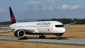 Air Canada plane taxiing on runway. Air Canada airplane doing taxi on runway stock image