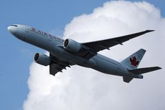 Air Canada airplane flying up in the sky. Air Canada plane, sunny sky on background stock images