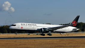 Air Canada plane landing on runway. Air Canada airplane landing on runway royalty free stock photography