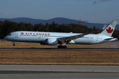 Air Canada airplane taking off from airport. Air Canada plane taking off from airport runway royalty free stock images
