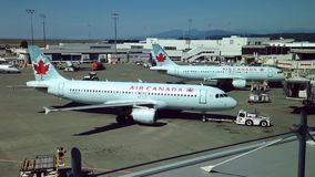 Air Canada airplanes prepare to flight at YVR airport stock video footage