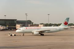 Air Canada commercial planes. Montreal, CA - 17 August 2017: Air Canada commercial planes on the tarmac of Montreal Pierre Elliott Trudeau International Airport royalty free stock photo