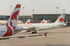 Air Canada commercial planes. Montreal, CA - 17 August 2017: Air Canada commercial planes on the tarmac of Montreal Pierre Elliott Trudeau International Airport royalty free stock image