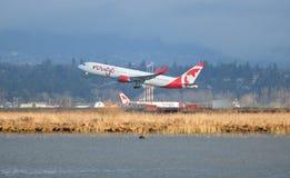 Air Canada et voler de coût bas Photographie stock libre de droits