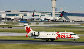 Air Canada Jazz CRJ in front of terminal Stock Images