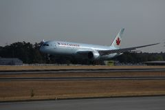 Air Canada landing on the runway. Air Canada doing taxi on the runway royalty free stock photo