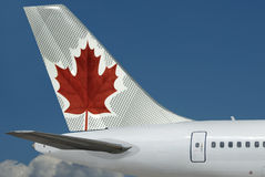Air Canada plane. Sky. Air Canada logo is on the tail of plane, close-up & on the beautiful blue sky background. The sky area is free for your text Stock Images