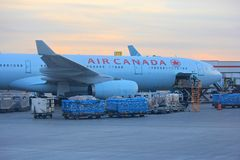 Air Canada plane at the Toronto airport. Air Canada plane unloading cargo at the international terminal - Toronto airport Stock Photo