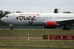 Air Canada Rouge taxiing on the runway. Air Canada Rouge doing taxi on the runway stock photography