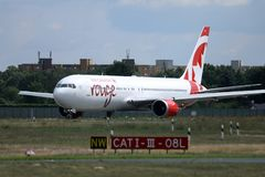 Air Canada Rouge taxiing on the runway. Air Canada Rouge doing taxi on the runway royalty free stock images