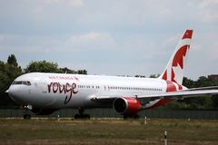 Air Canada Rouge taxiing on the runway. Air Canada Rouge doing taxi on the runway royalty free stock photo