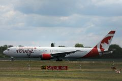 Air Canada Rouge taxiing on the runway. Air Canada Rouge doing taxi on the runway stock photos