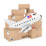 Air Cargo Concept. Cartoon Toy Jet Airplane with USA Flag near B Royalty Free Stock Image
