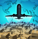 Air Cargo. Shipping concept with an airplane flying above a large group of mail courier packages on a three dimensional map of the world as a global overseas Royalty Free Stock Photos