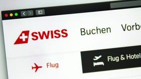 Air carrier Swiss website homepage. Swiss logo visible. Washington, USA - April 03, 2019: Air carrier Swiss website homepage. Swiss logo visible through a stock footage