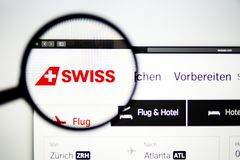 Air carrier Swiss website homepage. Swiss Airways logo visible through a magnifying glass. Washington, USA - April 03, 2019: Air carrier Swiss website homepage royalty free stock image