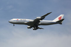 Air China Boeing 747 descending for landing at JFK International Airport in New York Royalty Free Stock Photo